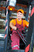 Warehouse worker driver in forklift — Photo