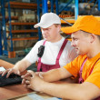 Manual workers in warehouse — Foto Stock
