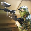 Paintball player under cover — Stock Photo #5996945