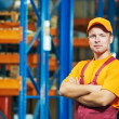 Caucasian young manual worker in warehouse - Stock Photo