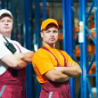 Young manual workers in warehouse — Stock Photo