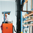 Warehouse forklift loader at work — Stock Photo #5997116