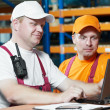 Stockfoto: Manual workers in warehouse