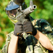 Paintball player holding fire — Stock Photo #5997242