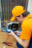 Repair work on fridge appliance — Foto de Stock