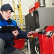 Heating engineer repairman in boiler room — Stock Photo #6023437