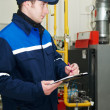 Heating engineer repairman in boiler room — Stock Photo #6023478