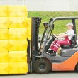 Worker driver at warehouse forklift loader works - Stock Photo
