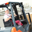 Warehouse worker driver in forklift — Stock Photo #6045209