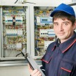 Electrician at work - Stock Photo