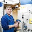Worker operating CNC machine center - Stockfoto
