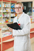 Pharmacy specialist in drugstore — Stock Photo