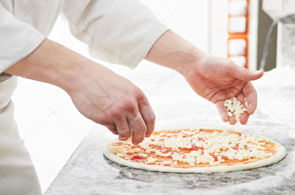 Closeup hand of chef baker in white uniform making pizza at kitchen — Foto Stock #6091785