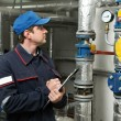Heating engineer repairman in boiler room — Stock Photo #6111722