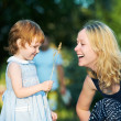Mother and child outdoors - Stock Photo