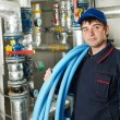 Heating engineer repairman in boiler room - Stock Photo