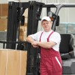 Warehouse worker in front of forklift — Stock Photo #6117049