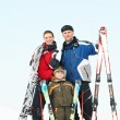 Happy sporty family at winter — Stok fotoğraf