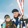 Stock Photo: Smiling son and father with skis at winter