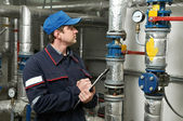 Heating engineer repairman in boiler room — Stock Photo