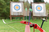 Archery equipment - bow arrows target — Stock Photo