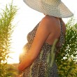 Pregnant woman in field — Foto Stock #6490810