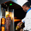 Arab chef making kebab - Stock Photo