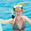 Royalty-Free Stock Photo: Smiling woman with snorkel equipment