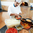 Arab baker chef making Pizza — Stock Photo #6493145