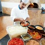 Arab baker chef making Pizza — Stock Photo