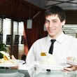 Waiter in uniform at restaurant — Zdjęcie stockowe #6494689