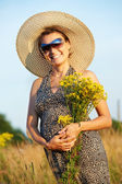 Pregnant smiling woman in field — Stock Photo