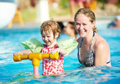 Woman and child in swimming pool — Stock Photo