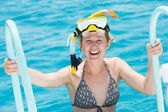 Smiling woman with snorkel equipment — Stock Photo