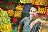 Arab youth invites to purchase fruits — Stock Photo