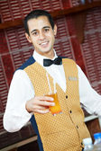 Cheerful arab barman — Stock Photo