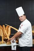 Arab chef cutting bread — Stock Photo