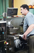 Worker at machining tool workshop — Stock Photo