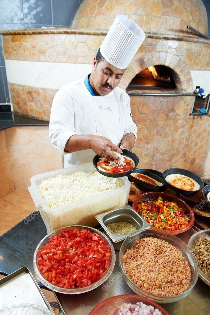 One arab chef baker in white uniform making pizza at kitchen  Stock Photo #6493145