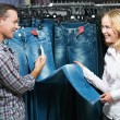 Young couple at clothes shopping — Stock Photo #6517652