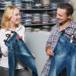 Young couple at clothes shopping — Stock Photo #6517675