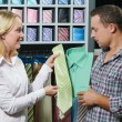 Young couple at clothes shopping — Stock Photo #6517706