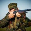 Stock Photo: Hunter with rifle gun