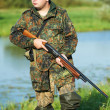 Hunter with rifle gun — Stock Photo #6589420