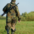 Hunter with rifle gun - Stock Photo