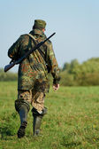 Hunter with rifle gun — Foto de Stock