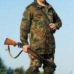 Hunter with rifle gun — Stock Photo