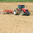 Ploughing tractor at field cultivation work — Stock Photo #6629443