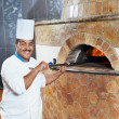 Arab baker chef making Pizza — Stock Photo #6693034