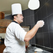 Royalty-Free Stock Photo: Pizza baker juggling with dough
